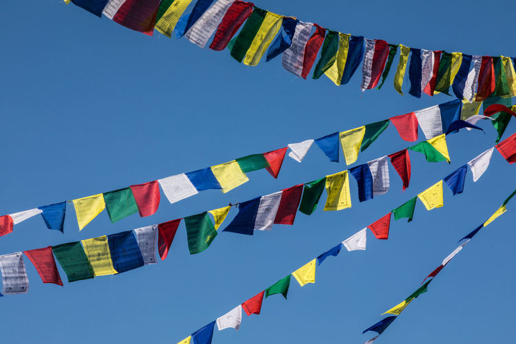 Nepal Prayer Flags  Multi Colored Hanging Sky Decoration Flag Blue Variation Celebration Sunlight Religion Wind Spriritual Peaceful