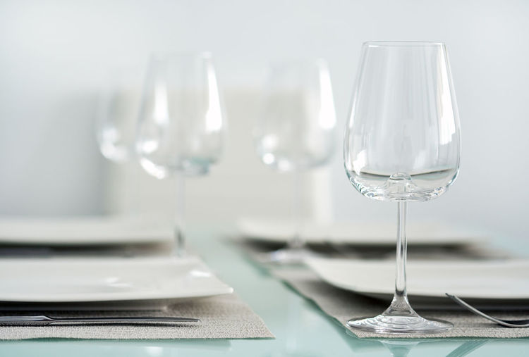 Table setting with a wine glasses, cutlery and plates Dinning Home Table Setting Table Arrangements Tableware Wine Glasses Close-up Drinking Glass Glass Glass - Material Glassware Household Equipment Indoors  Interior Interior Design No People Nobody Plate Restaurant Selective Focus Serving Setting Table Table Appointments Wineglasses