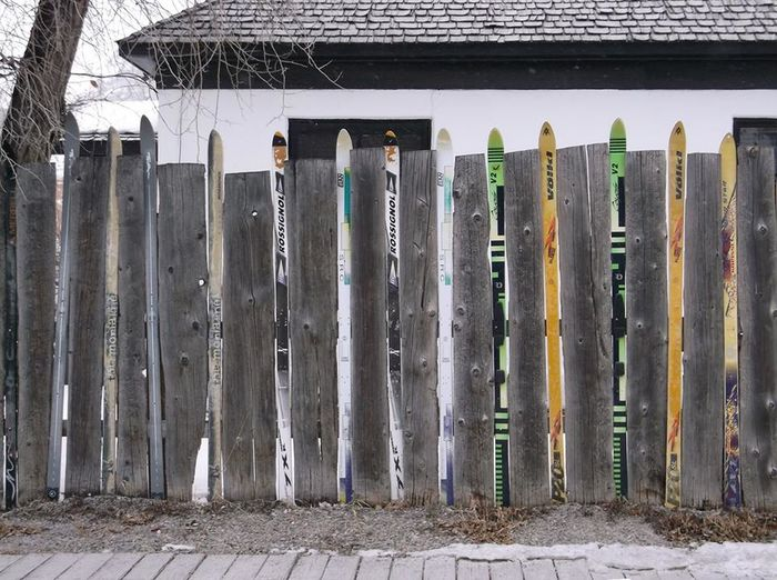 skii fence Skiing 🎿 Lifestyles Yard Art New Perspectives Snow Iron - Metal Large Group Of Objects Man Made Object No People Outdoors Weathered Privacy Fence Artistic Paralell Cloudy Day Human Representation Travel Wall - Building Feature City Life The Way Forward