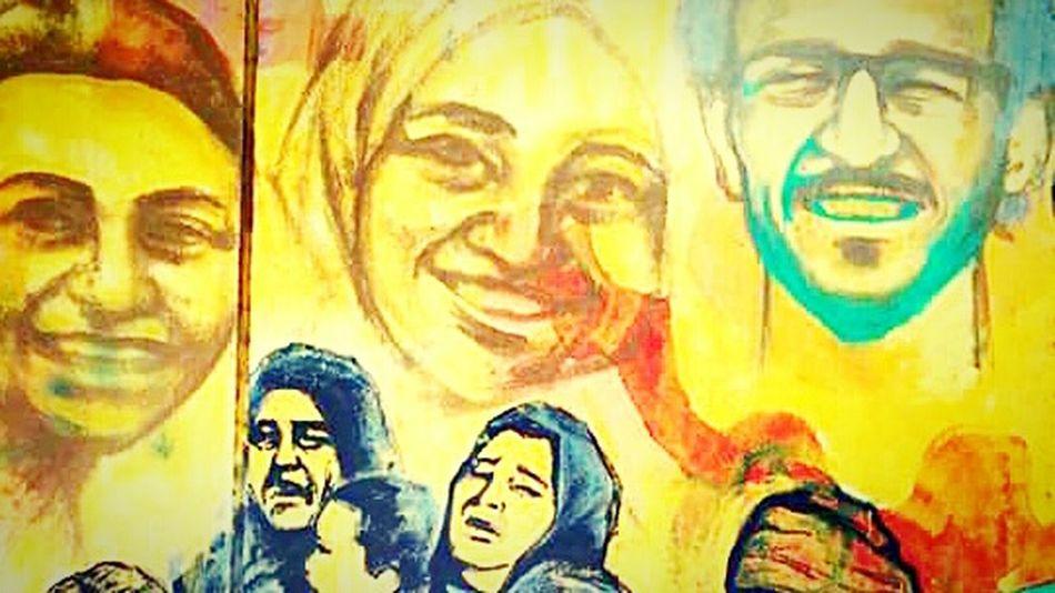 Street Graffiti at Mohamed Mahmoud Street , Egypt Martyrs Graffiti Revolution