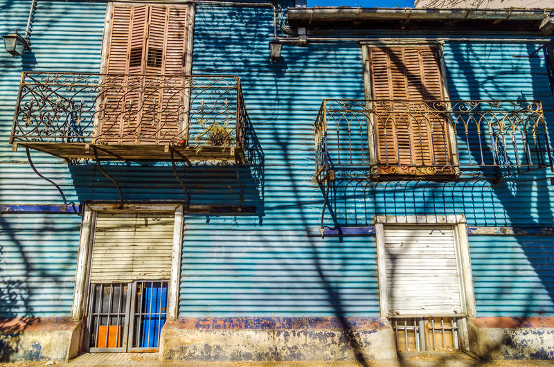 Blue corrugated siding of an old building in La Boca neighborhood of Buenos Aires, Argentina Architecture Argentina Balconies Balcony Blue Boca Buenos Aires Caminito Colorful Corrugated La Boca La Boca, Buenos Aires Landmark Latin Latino Neighborhood South America Tango Walls Window
