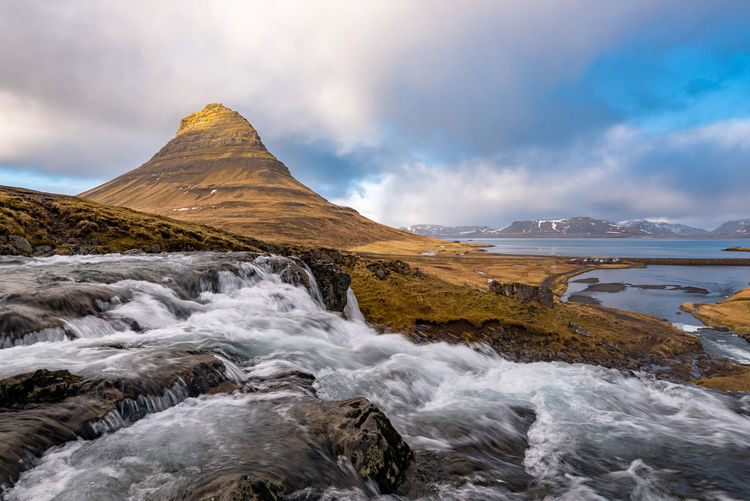 The kirkjufell mountain and the kirkjufellfoss waterfall at snaefellsnes peninsula in iceland