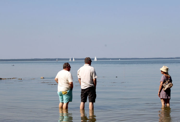 three persons at a sea Baden Blau Blue Calm Friendship Fun Hat Holidays Maurenrock Nature Outdoors Poland Polenta Rear View Reflections Sea See Sky Sommer Standing Stille Summer Travel Vacations Water The Street Photographer - 2019 EyeEm Awards