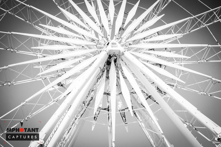 Amusement Park Amusement Park Ride Architecture Arts Culture And Entertainment Backgrounds Built Structure Circle Clear Sky Day Ferris Wheel Low Angle View Metal Motion No People Outdoors Part Of Pattern Sky Transportation Traveling Carnival