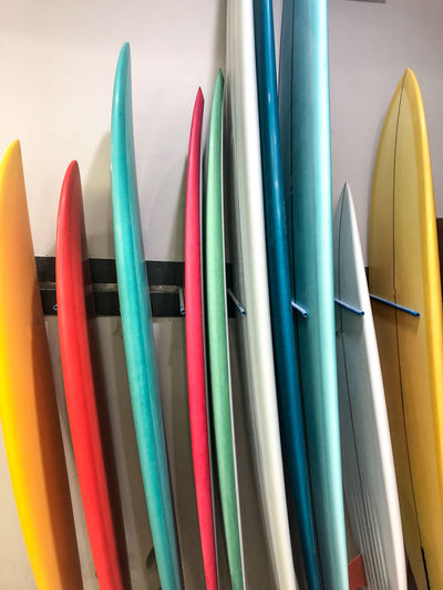 Close-up of colored surfboards