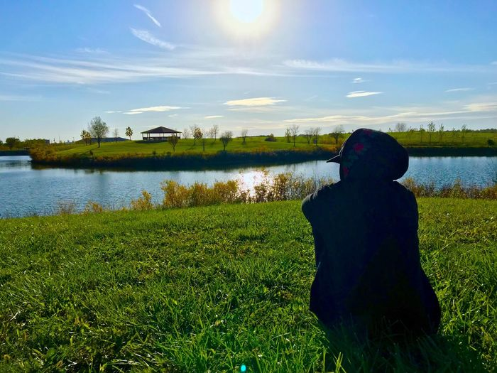 Watching more sunrises and sunsets than netflix📷🤷🏽♂️ Water Real People Nature Field Lake One Person Sky Grass Beauty In Nature Outdoors Day Lifestyles Leisure Activity Landscape Tranquility Mature Adult Youth Of Today Scenics Boys Childhood Second Acts