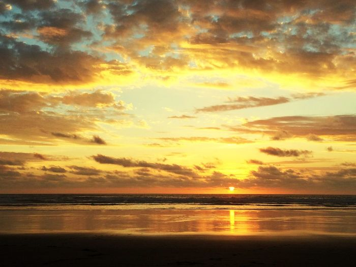 mellow yellow Water Sea Sunset Beach Low Tide Horizon Saturated Color Silhouette Awe Sunlight Romantic Sky Dramatic Sky Atmospheric Mood Coastline Cloudscape