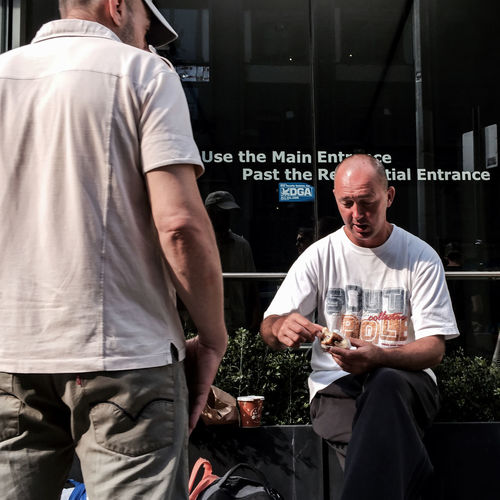 #Monday #men #working #summer2015 #chelsea #Manhattan #NYC #streetphotography #people #sunlight #breakfast #shadows Timyoungiphoneography