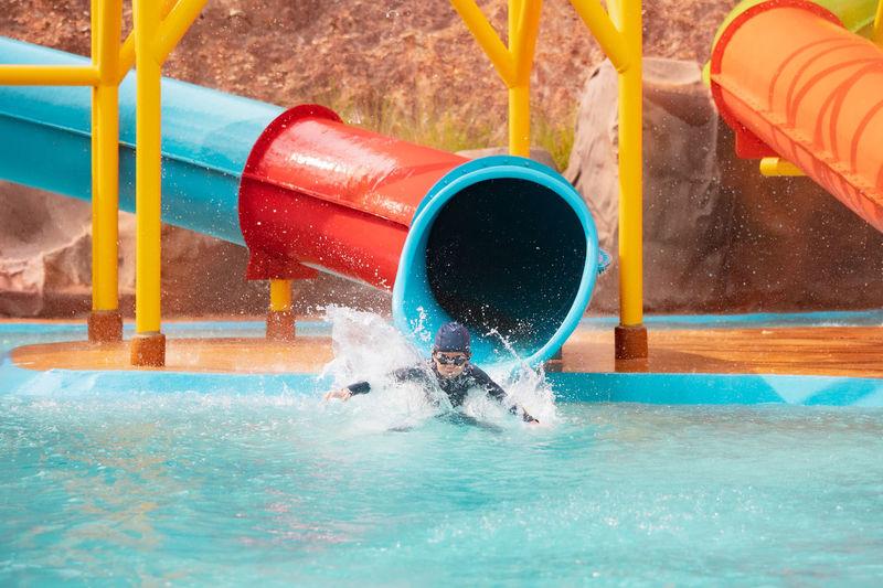 Water splashing in swimming pool at playground