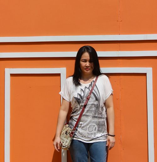 orange Standing One Person Three Quarter Length Casual Clothing Front View Wall - Building Feature Architecture Portrait Orange Color Looking At Camera Women