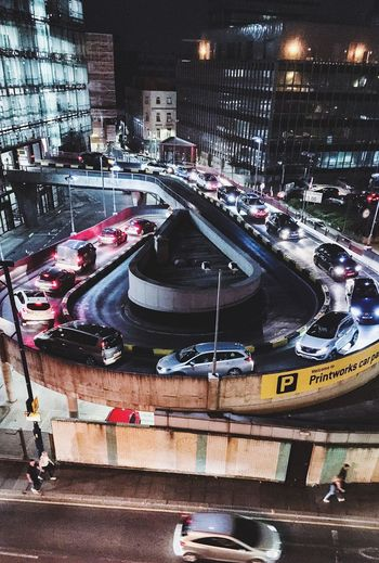 Carousel Transportation Car Motor Vehicle Mode Of Transportation City Land Vehicle Architecture Road Built Structure Street Building Exterior High Angle View City Street Night Traffic City Life Incidental People Illuminated on the move Travel The Street Photographer - 2018 EyeEm Awards Streetwise Photography