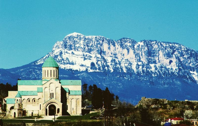 """Georgia, Kutaisi, Bagrati cathedral, mount """"khvamli"""" Love Nature Photography Photo Green No People Travel Destinations Colorful Tree Mountain Place Of Worship Religion Sky Architecture Building Exterior Built Structure Historic History Historic Building Old Ruin Castle Archaeology Cathedral Calm"""