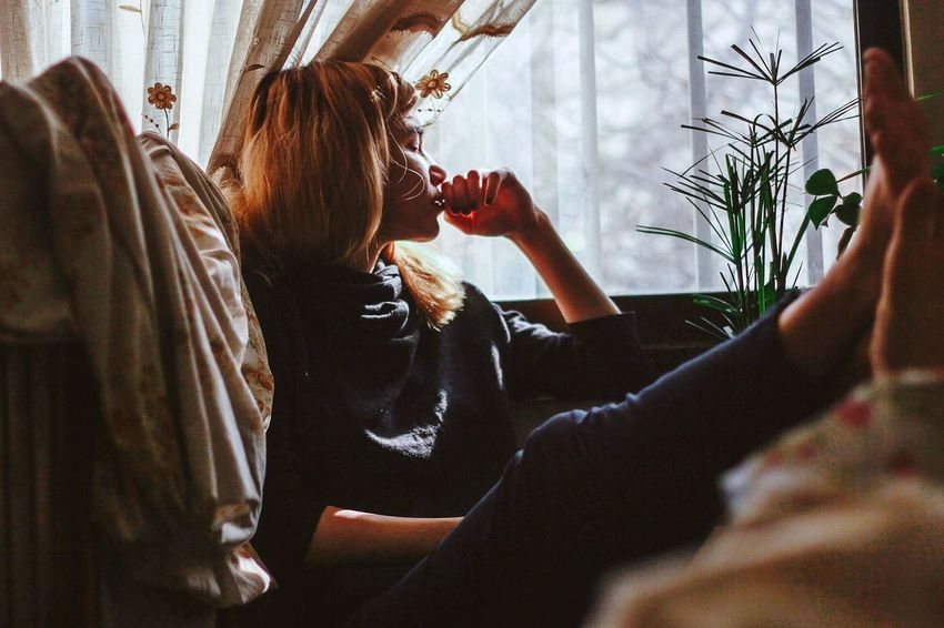 The worst part is waiting Real People Lifestyles One Person Indoors  Adult Sitting Leisure Activity Women Window Sunlight Casual Clothing Relaxation Day The Week On EyeEm Editor's Picks