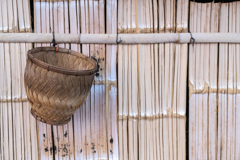 No People Indoors  Wood - Material Hanging Container Day Bamboo - Material Close-up Nature Built Structure Curtain Pattern Wall - Building Feature Architecture Brown Still Life Plant Full Frame Sticky Rice Steamer Basket Basket