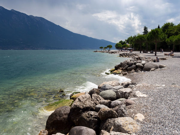 Beach at Lago di Garda Dramatic Sky Lago Di Garda Beach Clouds Day Italy Lake Landscape Mountain Nature Outdoors Pebble Pebble Beach Scenics Sky Tranquility Water