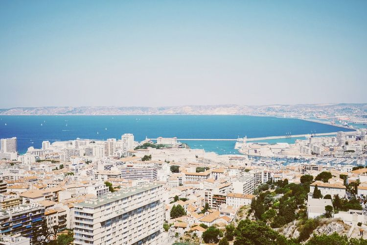 View of sea with cityscape in background