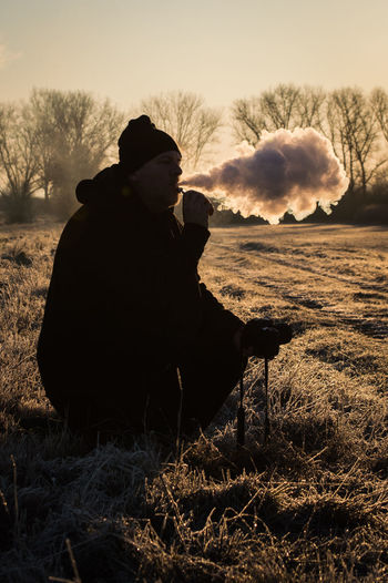 Silhouette Of Man Smoking Against Sky During Sunset