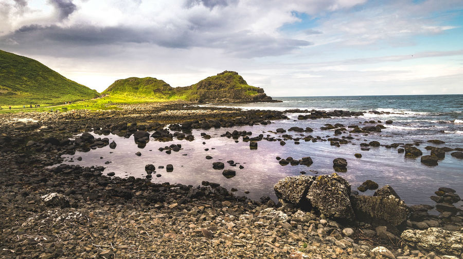 The giant's causeway in all it's contrasts and fascination feeds our imagination GiantsCauseway Landscape_Collection Landscape_photography Ireland Landscapes Water Sea Beach Sand Sky Cloud - Sky Close-up Landscape Rocky Mountains Scenics Idyllic Coast Tranquility Shore Tranquil Scene Rock Formation Seascape