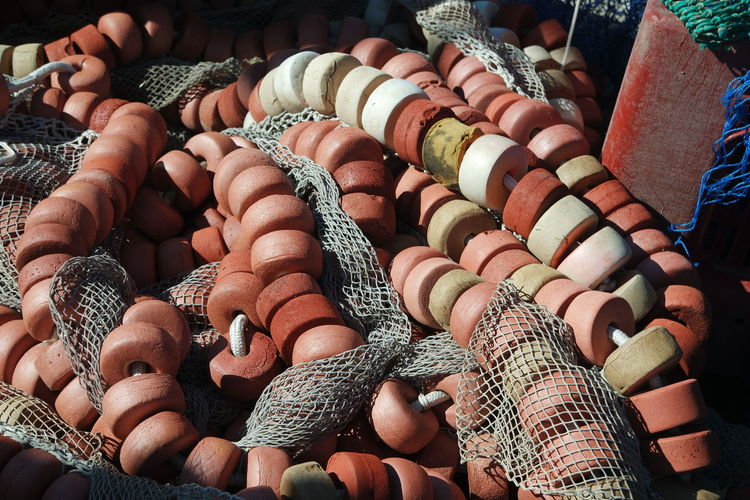High angle view of fishing net and buoys