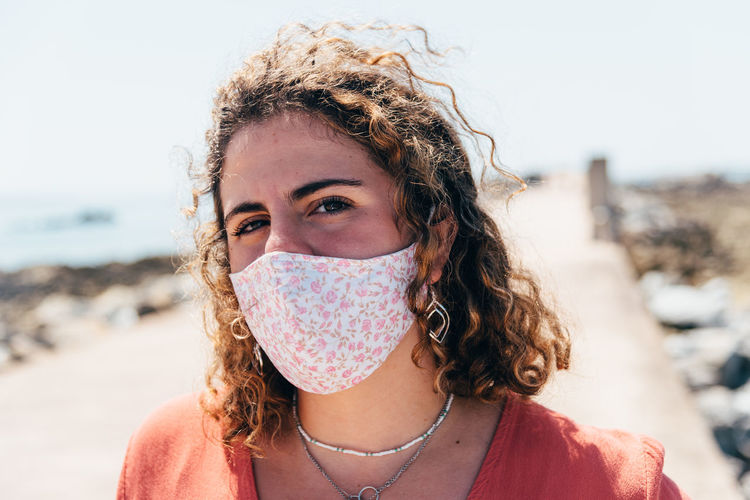 Portrait of beautiful woman wearing face mask