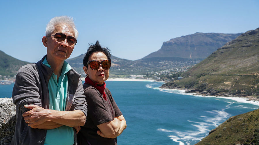 Asian senior couple anniversary trip to africa beautiful landscape and wild nature holiday