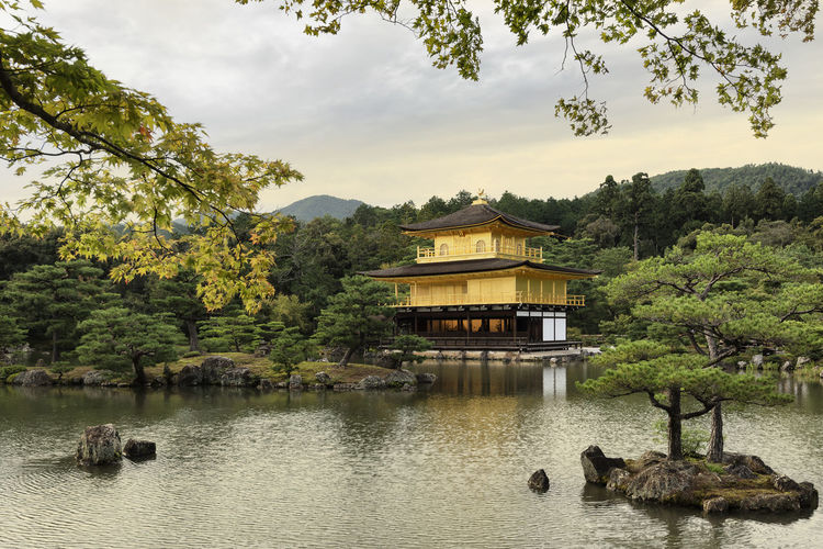 Kinkaku-ji Temple or Golden Pavilion during sunset, Kyoto, Japan Ancient Japan Architecture ASIA Buddhist Temple Evening Sky Famous Place Golden Pavilion  Historical Building Japan Kinkakuji Temple Kyoto Lake Landmark Landscape Nature No People Outdoors Place Of Worship Reflection Scenics Sky Sunset Travel Destinations Travel Photography Tree Summer Exploratorium