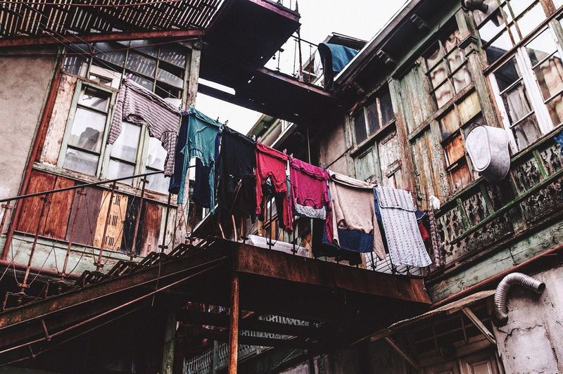 Window Building Exterior Architecture Built Structure Hanging Low Angle View Laundry Clothesline No People Drying Balcony Residential Building Day Outdoors Air Conditioner Sky