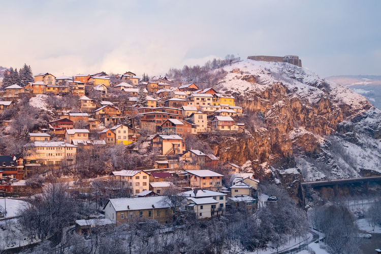 Townscape against sky during winter