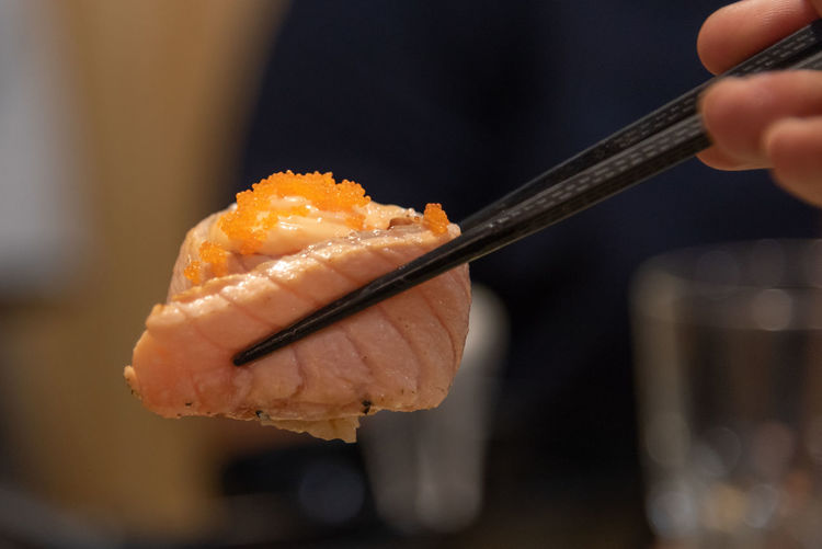 Human Hand Food Food And Drink Hand Holding One Person Human Body Part Freshness Chopsticks Japanese Food Focus On Foreground Indoors  Close-up Sushi Asian Food Healthy Eating Wellbeing Rice Seafood Finger