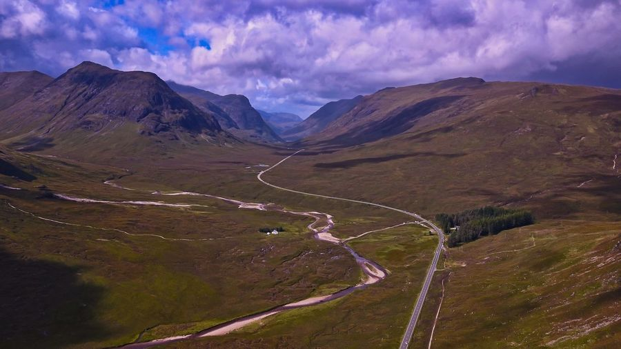 Glencoe Glencoe Scotland Scottish Highlands Highlands Mountain Cloud - Sky Environment Scenics - Nature Sky Landscape Beauty In Nature Nature Mountain Range Road No People Outdoors