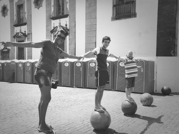 People standing on sphere balls on street