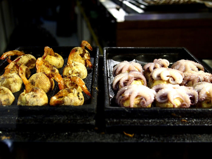 Assorted Takoyaki on display at a Japanese snack bar Asian  Japanese  Japanese Food Asianfood Takoyaki Takoyaki Ball Snacks! Snack Time! Shrimps Octopus Meal Appetizer Appetite Health Healthy Eating Healthy Food Diet Nutrition Meal Dumpling  Bakery Preparation  Close-up Food And Drink