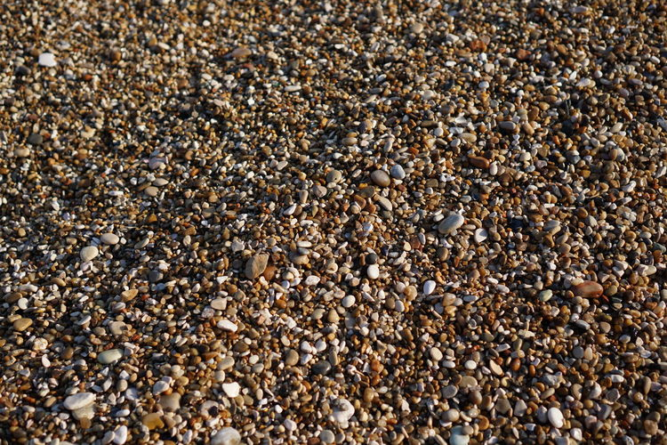 High angle view of pebbles at beach