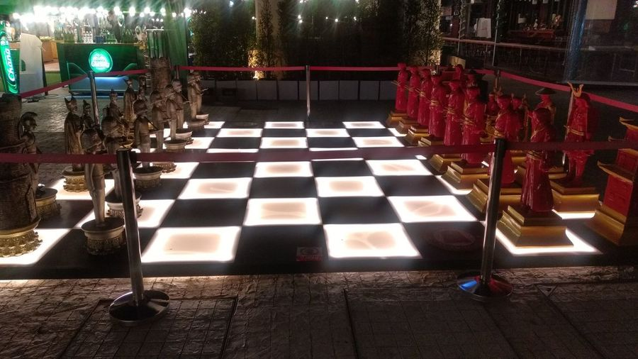 High angle view of illuminated lights on footpath at night