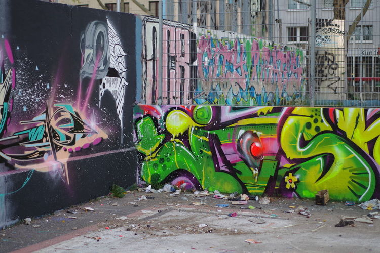 Graffiti on wall by street in city