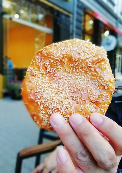 Man's hand holding a Bulgarian pastry in the streets of Sofia Pastry Bulgarian Food Food And Drink Salt Delicious Street Food Man's Hands Eating Discovering Travel Destinations Style Traditional Eat Cultural Enjoying Life Streetphotography Human Hand City Women Nail Polish Holding Dessert Human Finger Personal Perspective Close-up Sweet Food Sandwich Temptation Toasted Bagel Pie