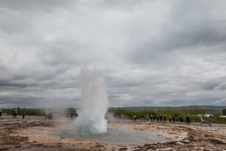 Strokkur geysir in Iceland Strokkur Geysir Geyser Cloud - Sky Sky Geology Power In Nature Physical Geography Nature Day Power Water Incidental People Steam Heat - Temperature Hot Spring Outdoors Environment Scenics - Nature Motion Landscape Spraying
