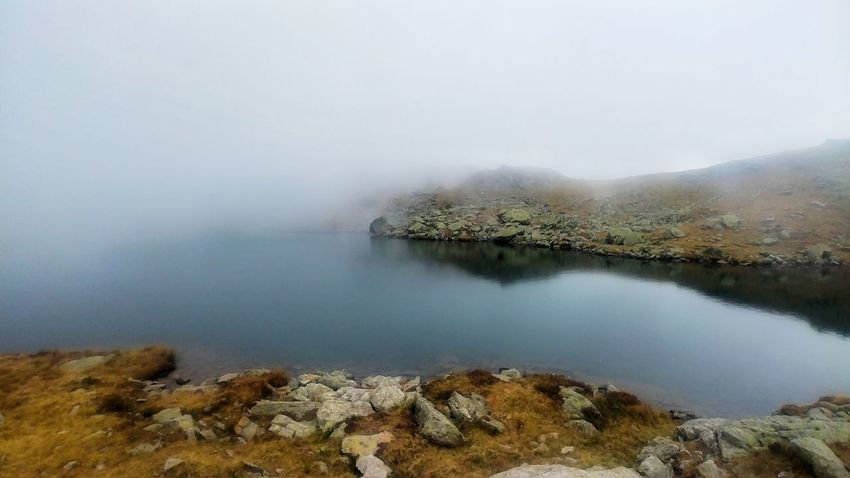 Fog Nature Lake Beauty In Nature Landscape Water Mountain Outdoors No People Day Scenics Travel Destinations Tranquility Physical Geography Vacations Power In Nature Sky Hot Spring