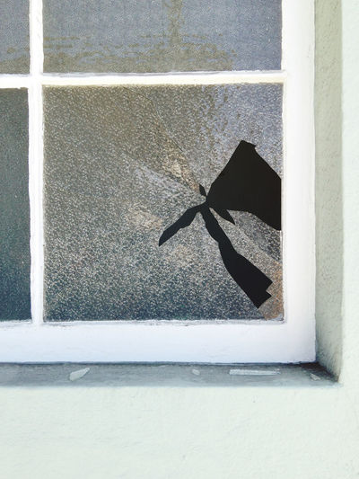 Close-up of window on concrete wall