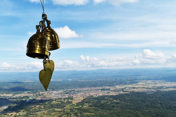 Bell and landscape against sky