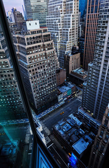 High angle view of street amidst buildings in city of manhattan new york