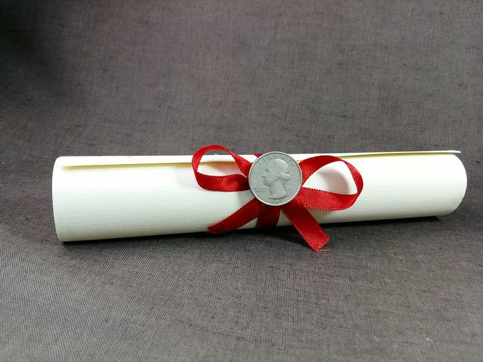 rolled diploma with medallion coin Rolled Diploma Ribbon Quarter Dollar George Washington Medallion Close-up Cloth