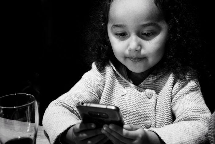 Preschooler Niklas Storm Okt 2018 Human Hand Wireless Technology Technology Child Childhood Portrait Headshot Sitting Black Background Cellphone Screen Using A New Beginning