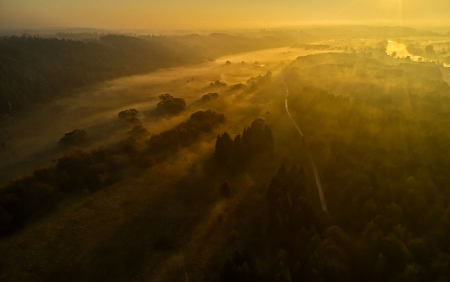 Aerial View Beauty In Nature Cloud - Sky Environment Fog Hazy  High Angle View Idyllic Landscape Nature No People Non-urban Scene Outdoors Plant Scenics - Nature Sky Sunset Tranquil Scene Tranquility Tree