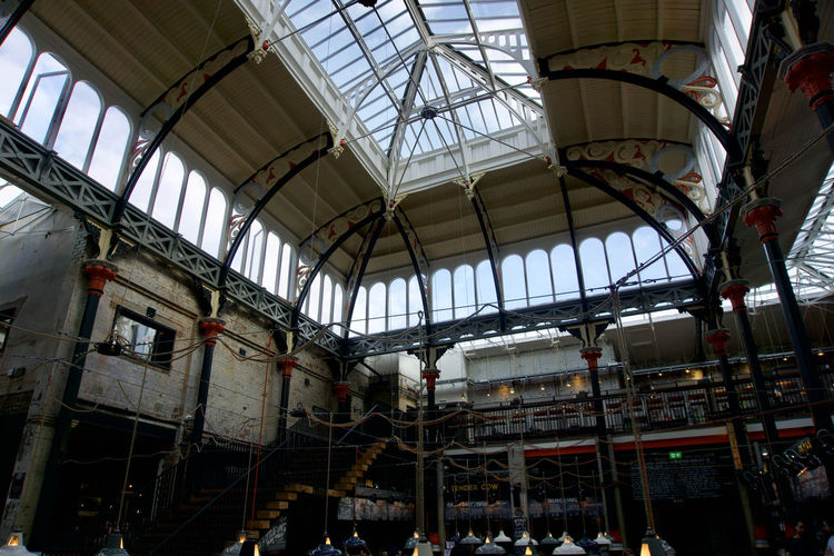 Northern Quarter market building detail in Manchester, UK Manchester Day Architecture Low Angle View Indoors  Built Structure Industry Factory Ceiling Metal Abandoned History Incidental People The Past Building Business Skylight Obsolete Window Ruined