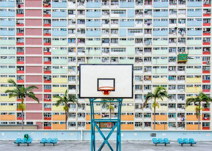 Basketball hoop against building in city
