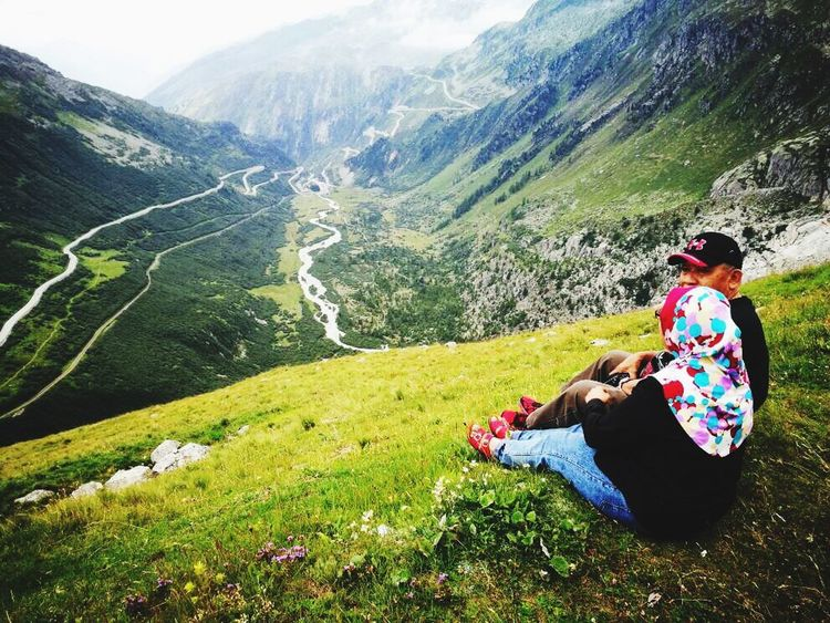 taking a breather... Mountain Sitting Mountain Range Beauty In Nature Grass Vacations Relaxation Scenics Adventure Landscape Outdoors Real People Furkapass Switzerlandpictures