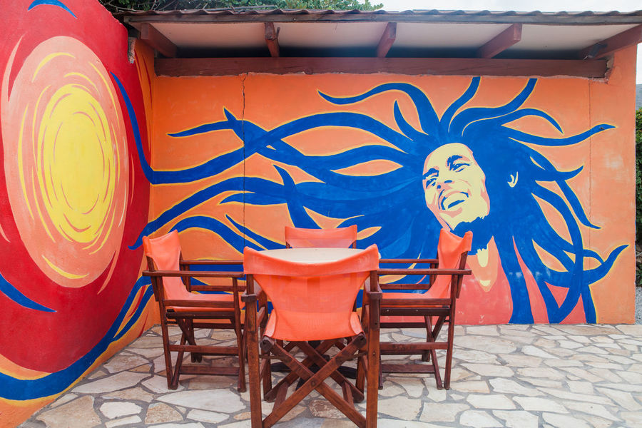 very colored outdoor cafè in Greece RASTA Bar Chair Day No People Outdoors Restaurant Table Bob Marley