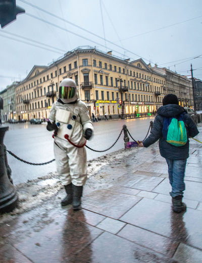 Cosmonaut St. Petersburg St. Petersburg, Russia Building Exterior Architecture City Full Length Real People Built Structure Men People Two People Winter Lifestyles Nature Casual Clothing Day Sky City Life Walking Cold Temperature Building Outdoors Warm Clothing