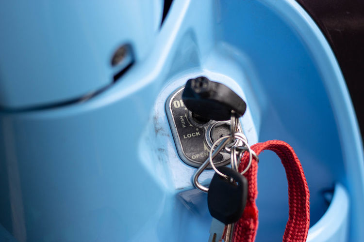 Close-up of key on motor scooter